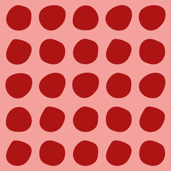 Red polka dot on pink background
